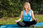Mature Woman Yoga with Copyspace — Stock Photo