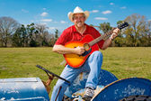 Singing Cowboy Strums Guitar — Stock Photo
