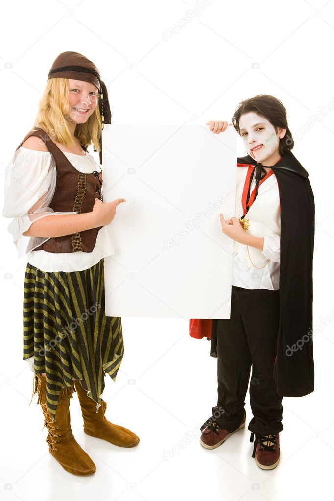 Brother and sister in Halloween costumes holding a blank white sign.  Full body design element, isolated on white.   — Stock Photo #6652110