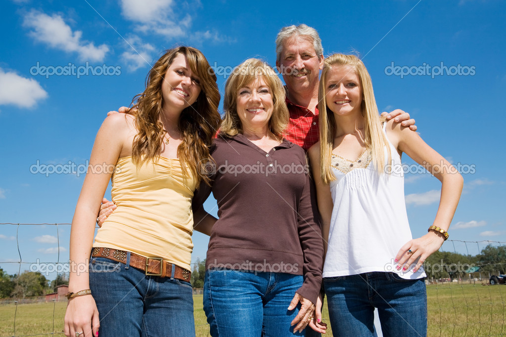 Grandparents and their beautiful teen granddaughters outside on the farm.    Foto Stock #6652269