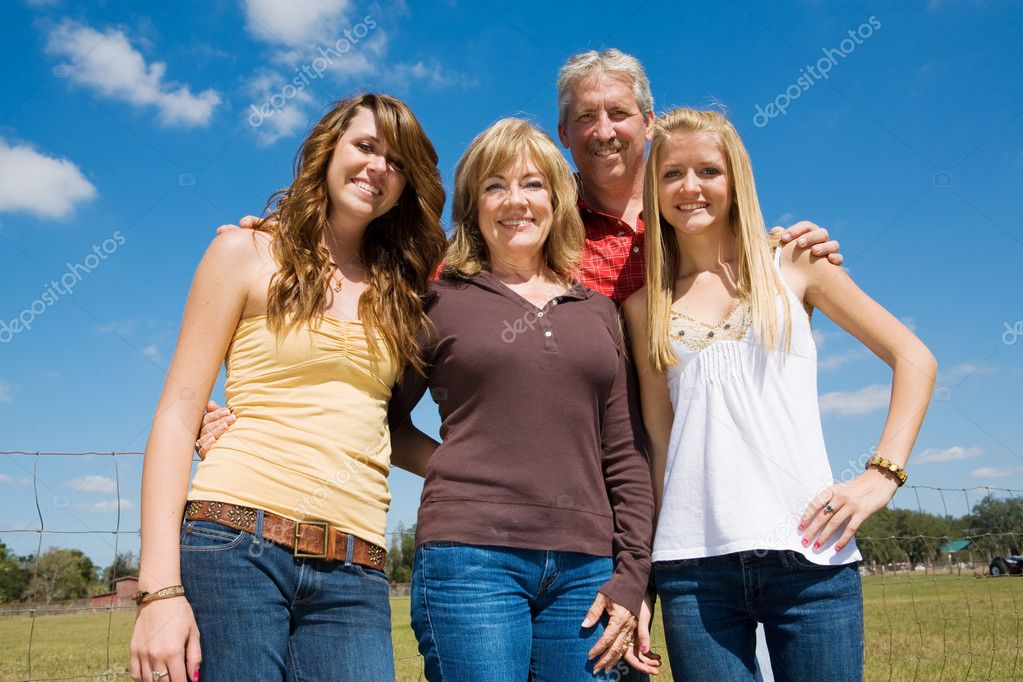 Grandparents and their beautiful teen granddaughters outside on the farm.   — Foto Stock #6652269