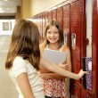 Gossip by Lockers - Stock Photo