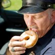 Hungry Police Officer — Stock Photo #6667714