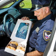 Hungry Policeman — Stock Photo