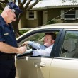 Police - Writing Ticket - Stock Photo
