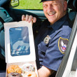 Police Officer - Box of Donuts — Stock Photo #6667783
