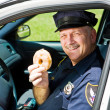 Stock Photo: Police Officer and Doughnut