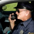 Police Officer on Radio — Stock Photo #6667856