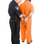 Policeman Handcuffs Prisoner — Stock Photo