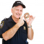 Policeman Loves Donuts — Stock Photo