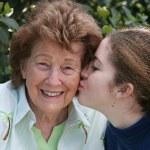 Girl Kisses Grandmother — Stock Photo #6668525