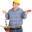 Electrician Confused by Plumbing - Stock Photo