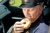 Hungry Police Officer — Stock Photo