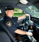 Police Officer Drives Squad Car — Stock Photo