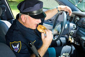 Police Officer Eating Donut — Stock Photo