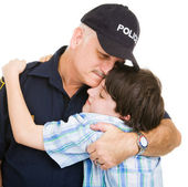 Police and Boy Hug — Stock Photo
