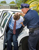 Shoved in Police Car — Stock Photo