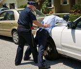 Spread Eagle on Police Car — Stock Photo