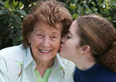 Girl Kisses Grandmother — Stock Photo