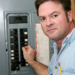 Electrician At Breaker Panel — Stock Photo