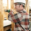Stock Photo: Carpenter Drilling Safely