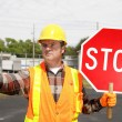Construction Crew Stop Sign - Stock Photo