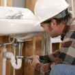Construction Plumbing Work - Stock Photo