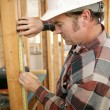Construction Worker Measuring — Stock Photo