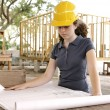 Engineering Student Reads Blueprints — Stock Photo #6671416