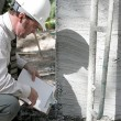 Building Inspector Checks Foundation — Stok fotoğraf
