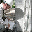 Stock Photo: Building Inspector Checks Foundation