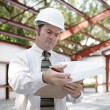 Stock Photo: Construction Inspector - Reviewing Notes