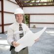 Construction Inspector with Blueprints — Stock Photo