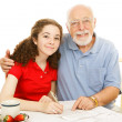 Stock Photo: Grandfather Helping Teen