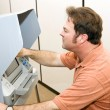 Man Votes on Touch Screen - Stock Photo