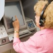 Stock Photo: Senior Lady Votes on Touch Screen