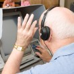 Senior Man Uses Touch Screen — Stock Photo