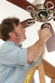 Electrician Installing Ceiling Fan — Stockfoto