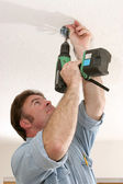 Electrician Installing Fan Box — Stock Photo