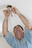 Electrician Pulling Wire — Stock Photo