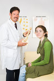 Happy Chiropractor and Patient — Stock Photo