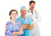 Equipe medica su bianco — Foto Stock