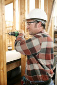 Carpenter Drilling Safely — Stockfoto