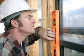 Carpenter Leveling Window — Stock Photo