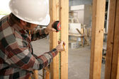 Construction Electrician Measuring — Stock Photo
