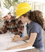 Engineering Student Marking Blueprints — Stock Photo