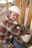 Plumber Repairs Toilet — Stock Photo