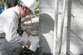 Building Inspector Checks Foundation — Stock Photo