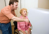 Poll Worker Assists Sr. Voter — Stock Photo