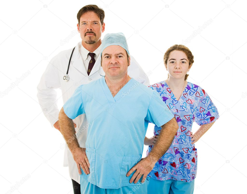 Competent trustworthy medical team - doctor, surgeon and nurse.  Isolated on white.  Stock Photo #6671328